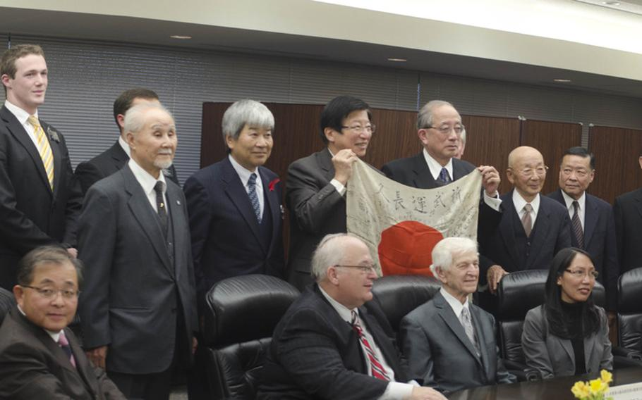 Kenneth Udstad, former Marine and World War II veteran, meets with Japanese officials in Shizuoka, Japan, after returning a flag and other items he recovered from dead soldiers during WWII.