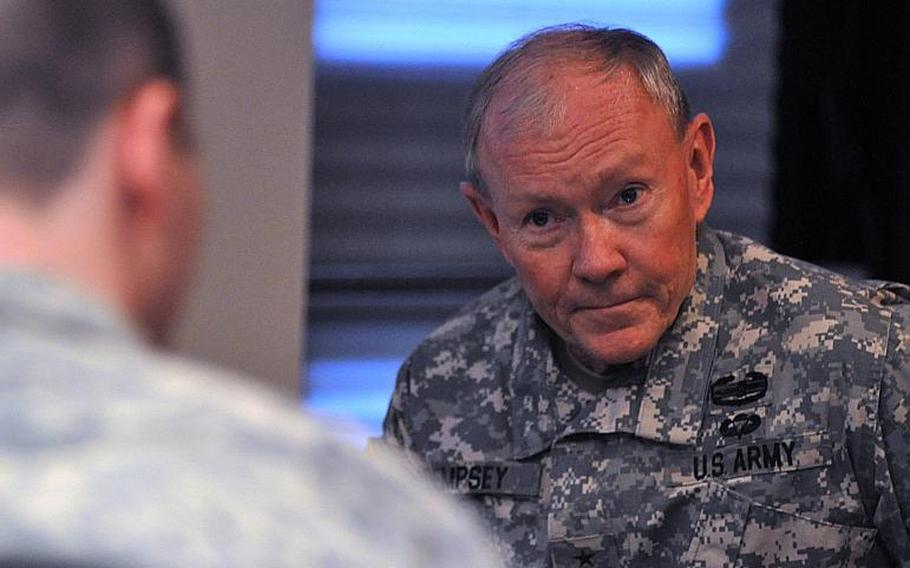 Chairman of the Joint Chiefs of Staff Gen. Martin  Dempsey answers questions during an interview Wednesday, December 11, 2013, with Stars and Stripes before a town hall meeting with servicemembers at Aviano Air Base, Italy. Servicemembers asked questions concerning cuts to pay, retention and changes to fitness habits that will affect servicemembers in the near future.