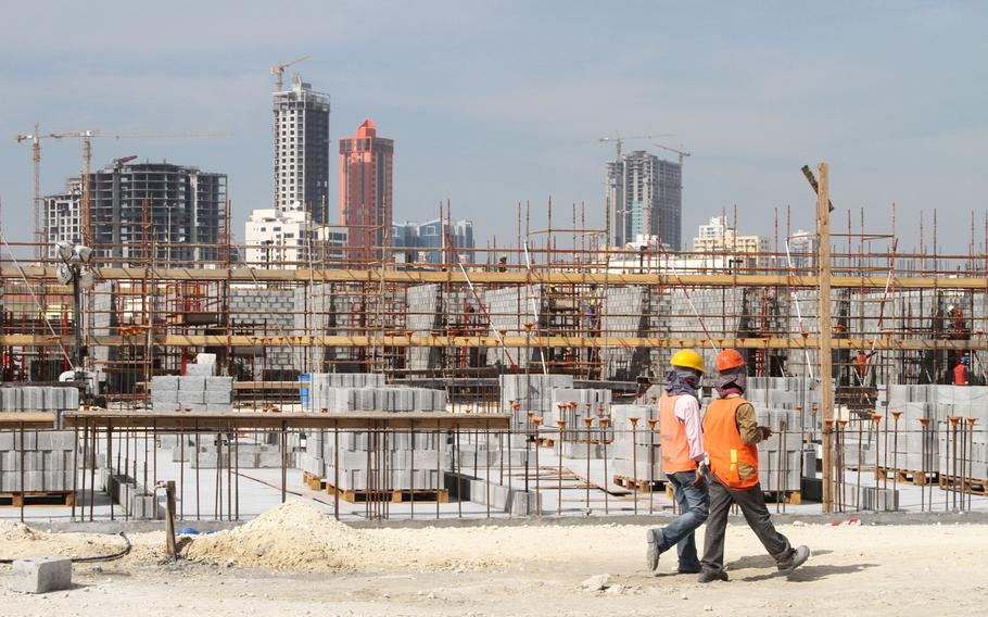 New Navy barracks are being built on 77 acres of land along Bahrain's waterfront, Dec. 5, 2013. The construction is part of the expansion of Naval Support Activity Bahrain.