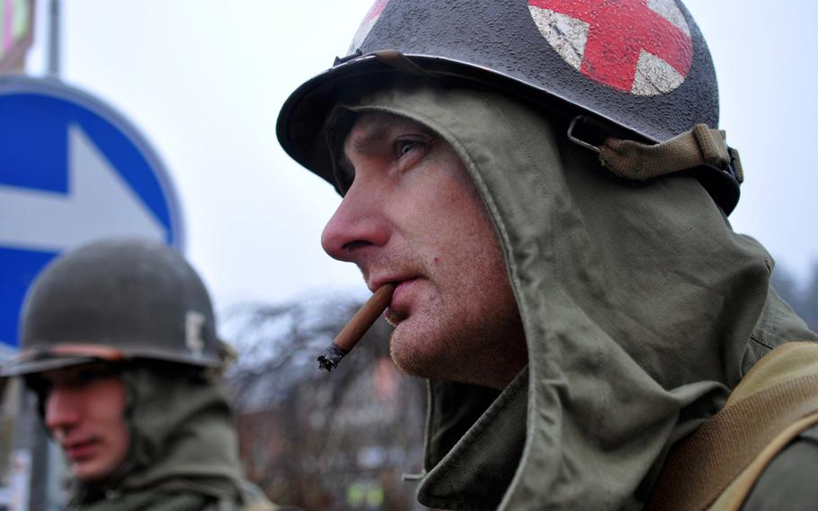 Danny Franken, foreground, and Stefen Groenewegen wait for the start of events commemorating the Allied defense of Bastogne, Belgium in World War II on Dec. 14, 2013. The pair are members of a Dutch re-enactment group that came to the town to participate in the Bastogne December Historic Walk.
