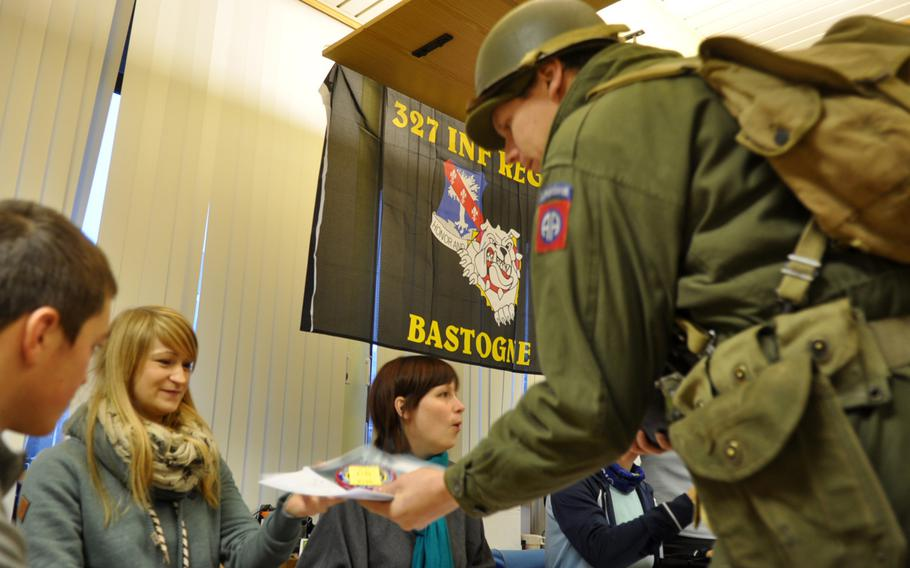 Participants sign up for the 36th annual Bastogne December Historic Walk on Dec. 14, 2013, to commemorate the Battle of the Bulge during World War II. Organizers say the proceeds of the walk were donated to a program designed to help veterans visit memorials on the National Mall in Washington, D.C.