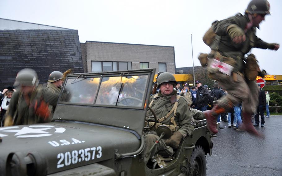 Re-enactors from Belgium dismount a restored jeep on Dec. 14, 2013, as they prepare to participate in a walk to commemorate World War II's Battle of the Bulge.