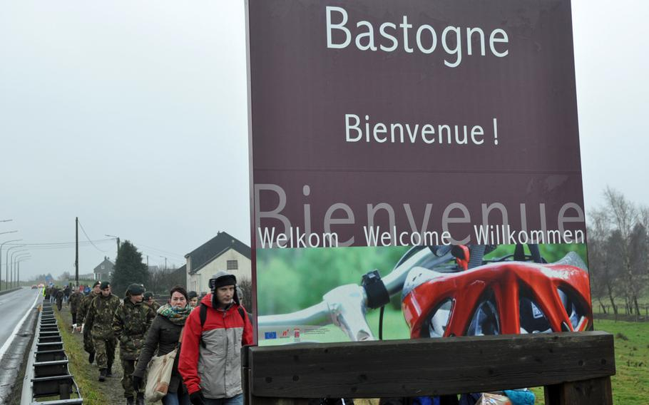 Participants leave the town limits of Bastogne, Belgium, during the 36th Annual Bastogne December Historic Walk. The walk commemorated the 69th anniversary of the siege of the town by German forces during World War II.
