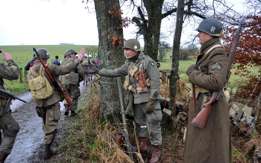Re-enactors greet each other during the 36th annual Bastogne December Historic Walk, held to commemorate the Battle of the Bulge in World War II.