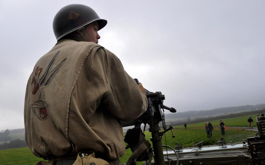 Johan Wynen, a World War II re-enactor from Belgium, mans a machine gun on Dec. 14, 2013, during an event to commemorate the Allied defense of the town of Bastogne during World War II. Spectators and re-enactors flooded the countryside around the town to remember the costly battle.