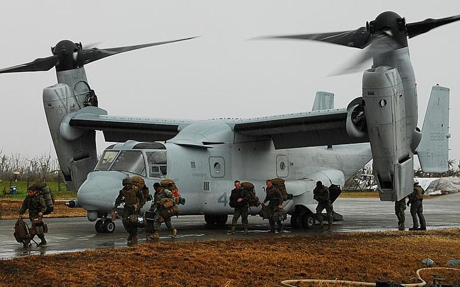 Marines get off a V-22 Osprey at the typhoon devastated town of Guiuan in the Philippines in November 2013.