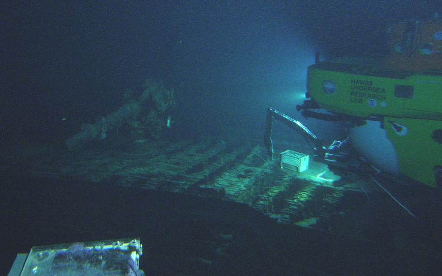The I-400's deck gun comes into view of the Pisces V submersible in August 2013 off the coast of Oahu.