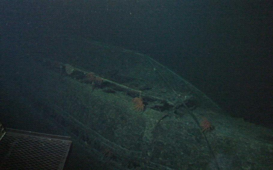 The hulking hull of the I-400 comes into view from the depths. When it was completed in 1944, the submarine was the largest ever built at 400-feet long with a surface displacement of 3,530 tons - a record that stood until the nuclear-powered subs of the 1960s. The submarine had a range of 37,500 miles and was able to travel around the world one and a half times before it needed refueling, something that remains unmatched to this day by any other diesel-electric submarine.