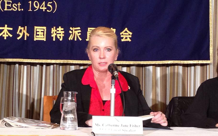 Catherine Jane Fisher, who recently settled with a former U.S. sailor she accused of raping her in 2002, speaks to reporters in Tokyo during a November press conference. A Milwaukee circuit court upheld the validity of a Japanese civil court ruling in her favor.
