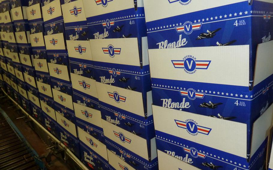 Stacks of boxes for Veteran Beer Company's Blonde Bomber American Blonde Ale sit idly during their first production run in November 2013.