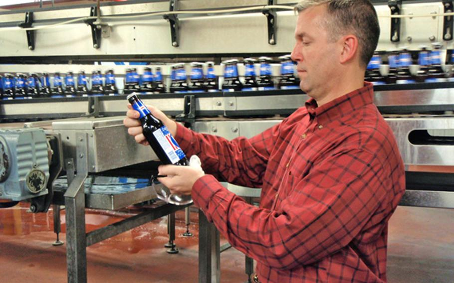 Bottles whiz past Veteran Beer Company brewer Eric Rine, a retired Marine lieutenant colonel, as he inspects a label at the company's Cold Spring, Minn., brewing facility. Veteran Beer Company opened in November, servicing Illinois and Indiana, and is owned and operated entirely by veterans. The company markets its employees and the veteran brand to help give jobs to disabled and non-disabled veterans. Employees also get stake in the company.