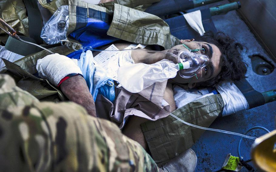 A wounded Afghan soldier is loaded onto a UH-60 Black Hawk medevac bird, Oct. 22, 2013, at Forward Operating Base Azizullah.
