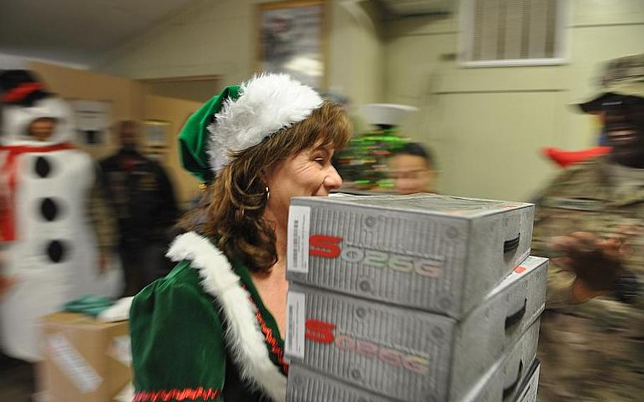 Elf and Forward Operating Base Fenty USO Director Regina Wages brought toys from Santa's workshop to raffle off during a Christmas party. Lucky boys and girls could win anything from Green Beans coffee gift cards to a Kindle Fire.
