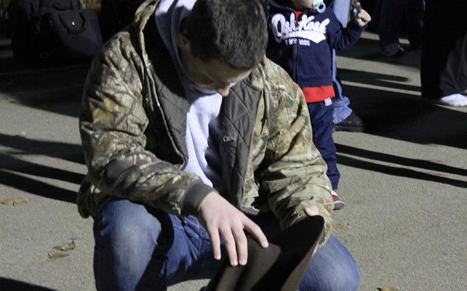 Daniel Hunt, 15, prays while waiting for his father, Cmdr. Thomas Hunt, to board a bus for a yearlong deployment to Afghanistan. The elder Hunt is a chaplain with I Marine Expeditionary Unit (Forward).