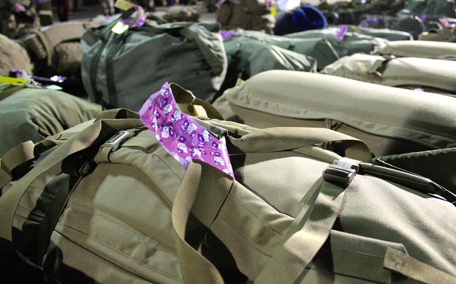 Marines with the Operations Coordination Center, which left Camp Pendleton, Calif., Monday morning for Afghanistan, marked their bags with Hello Kitty tape so they will be able to spot them. The unit is going to Afghanistan as part of I Marine Expeditionary Force (Forward) and the Marines will advise Afghan forces during their tour.
