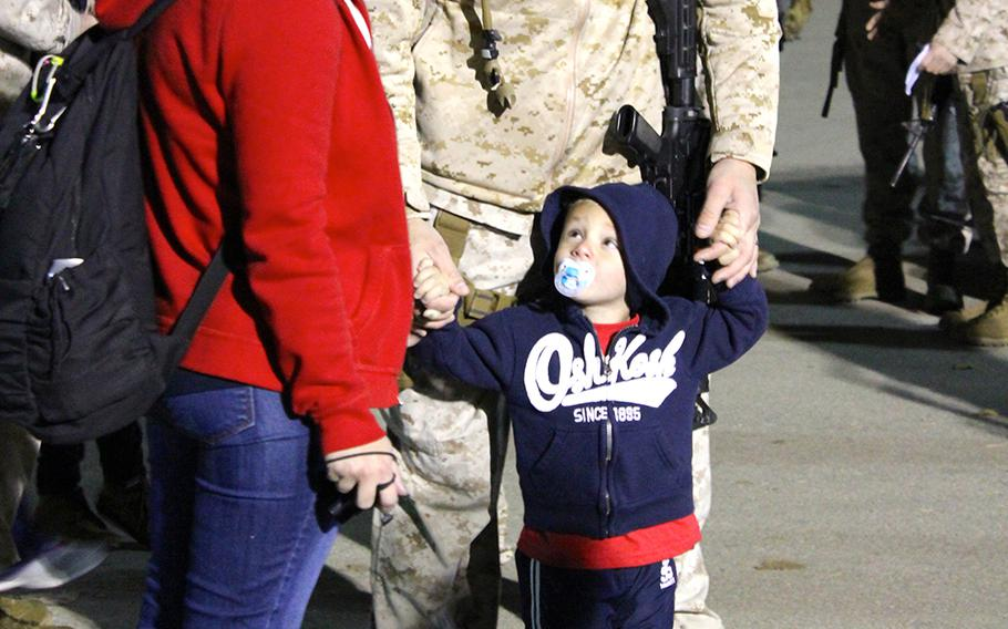 2nd Lt. Patrick Fedak spends a few minutes with his wife, Christi, and his 3-year-old son, Austin, before leaving for a yearlong deployment to Afghanistan with I Marine Expeditionary Force (Forward). Fedak deployed several times as an enlisted Marine, but this will be his first deployment since Austin was born.