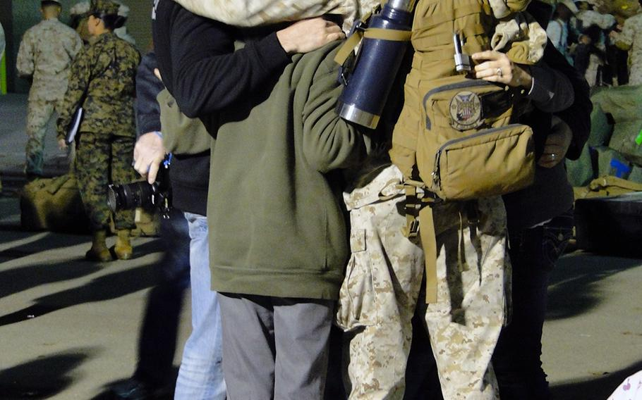 A family embraces their Marine at Camp Pendleton, Calif., Monday morning, before he leaves for a yearlong deployment with I Marine Expeditionary Force (Forward).
