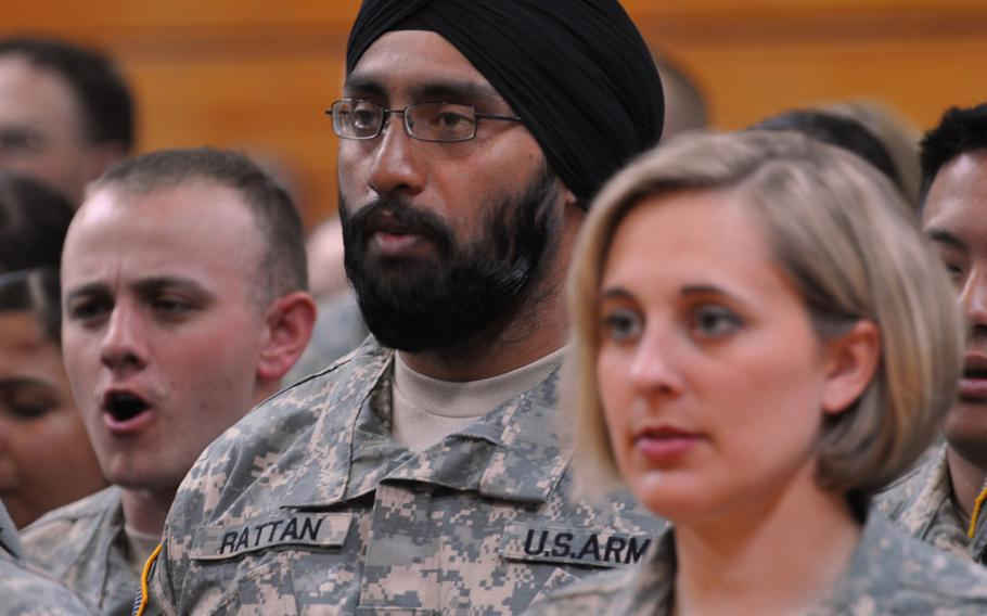Capt. (Dr.) Tejdeep Singh Rattan joins his graduating class in singing 'The Army Goes Rolling Along' during the Basic Officer Leadership Course graduation ceremony in 2010, at Fort Sam Houston, Texas. If requests 'reflect sincerely held beliefs' and 'don't harm readiness, unit cohesion or good order and discipline,' beards, turbans and other signs of spiritual devotion will be approved by the military under a new policy by the Pentagon.