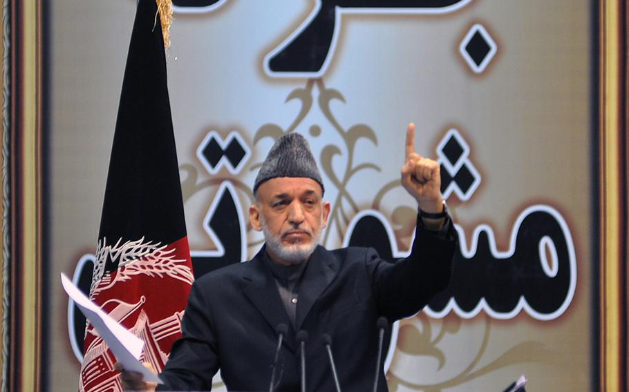 Afghan President Hamid Karzai addressed the Loya Jirga, a gathering of Afghan leaders, on Nov. 24, 2013, when the group endorsed a proposed security agreement with the U.S. to keep a military training and assistance force in Afghanistan past the end of 2014. Karzai has refused to sign the agreement, straining relations with the U.S.