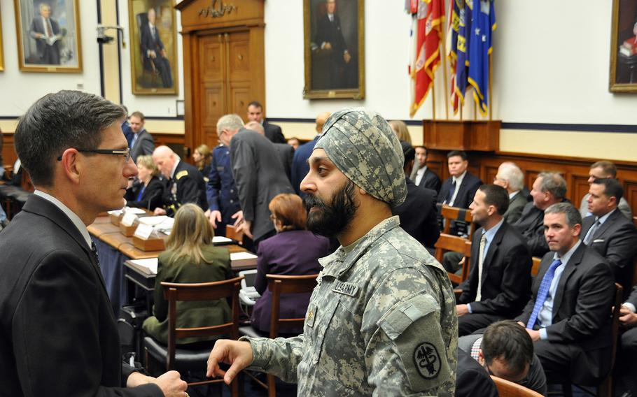 Army Reserve Maj. Kamal S. Kalsi speaks with U.S. Rep. Joe Heck, R-Nev., before the start of a hearing on a new Defense Department directive that provides guidance on uniforms and grooming with respect to religious beliefs at a House Armed Services Committee personnel subcommittee on Capitol Hill on Wednesday, Jan. 29, 2014.