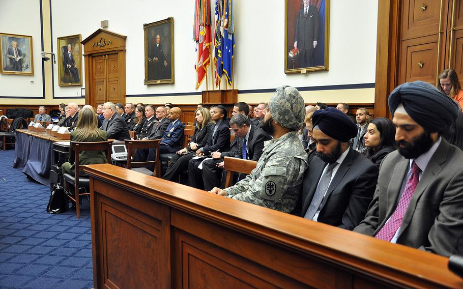 Army Reserve Maj. Kamal S. Kalsi and other Sikhs attend a hearing on a new Defense Department directive that provides guidance on uniforms and grooming with respect to religious beliefs at a House Armed Services Committee personnel subcommittee on Capitol Hill on Wednesday, Jan. 29, 2014.
