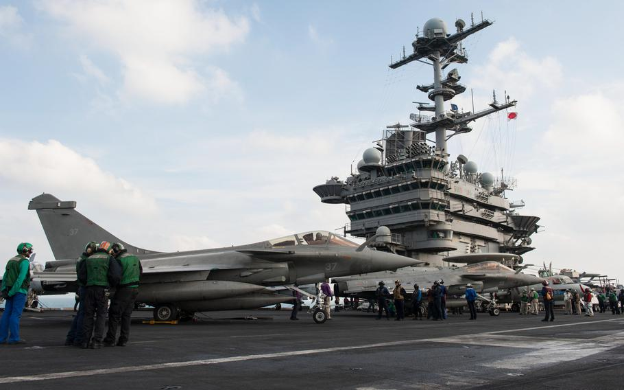 Two F1 Rafales, attached to the French aircraft carrier Charles de Gaulle, refuel on the flight deck of the aircraft carrier USS Harry S. Truman during carrier qualification integration Jan. 13, 2014, in the Persian Gulf.