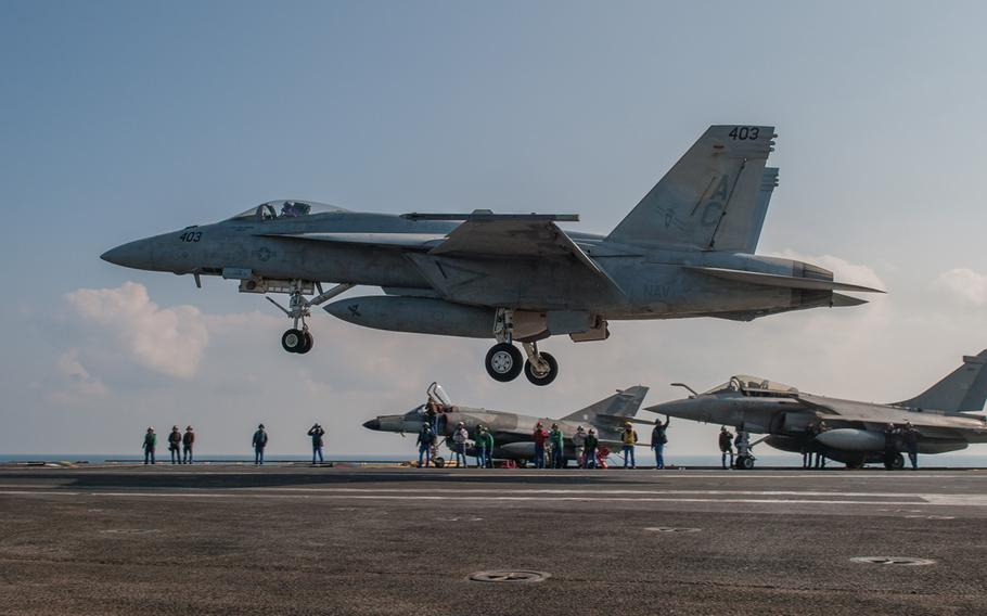 """An F/A-18E Super Hornet, assigned to the """"Gunslingers"""" of Strike Fighter Squadron 37, lands aboard the aircraft carrier FS Charles de Gaulle Jan. 13, 2014, in the Persian Gulf."""