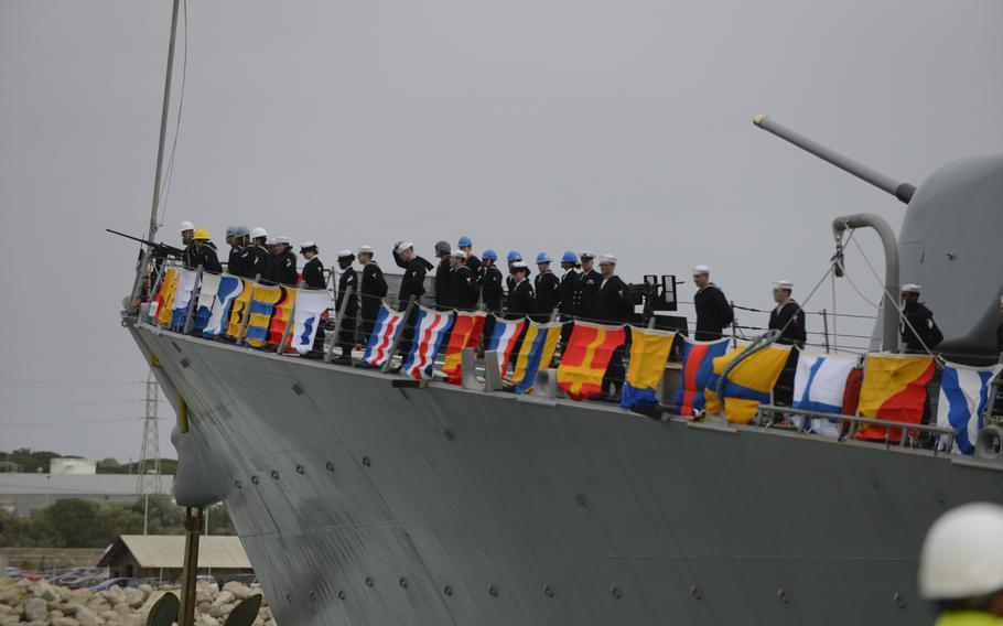 Sailors aboard the guided-missile destroyer USS Donald Cook  man the rails as the ship arrives in Rota, Spain, on Tuesday, Feb. 11, 2014.