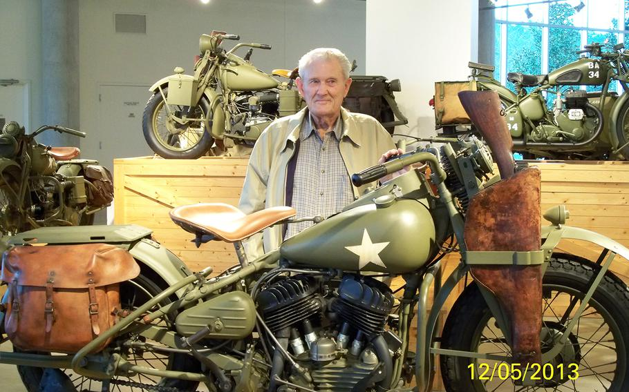 Bill Burton, 89, stands next to a military Harley, identical in vintage to the one he rode while a soldier in World War II. When he was issued that bike, it was named ???Ginny,??? which was his mother???s name.
