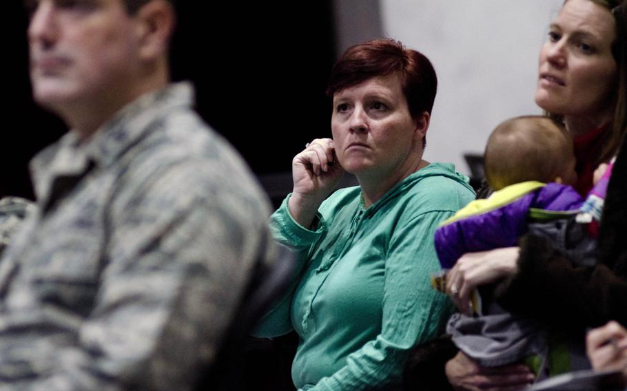 Airmen and their families gathered at the Airman Readiness Center at Yokota Air Base, Japan, on February 12, 2014, to get information about the U.S. Air Force's force reduction plan.