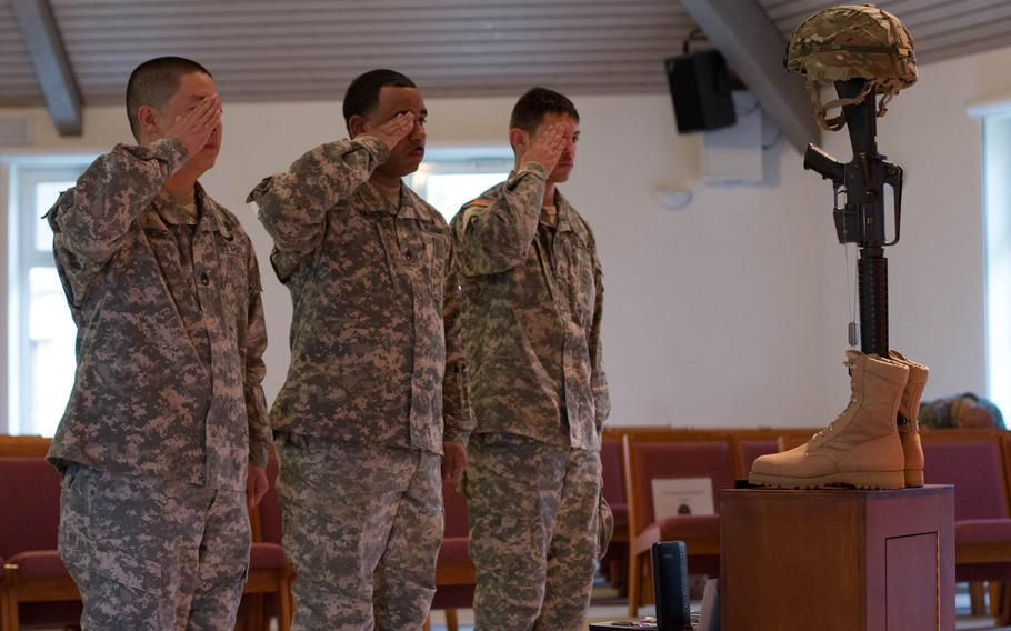The 2nd Cavalry Regiment says goodbye to Chief Warrant Officer 2 Edward Balli at a memorial service on Feb. 12, 2014.