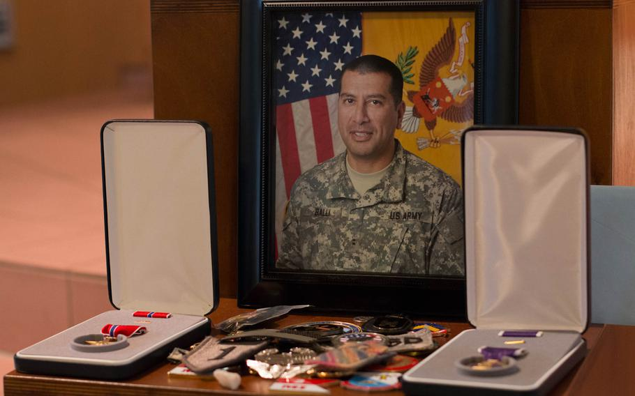 A portrait of Chief Warrant Office 2 Edward Balli and his medals were displayed at his memorial service in Vilseck on Feb. 12, 2014.