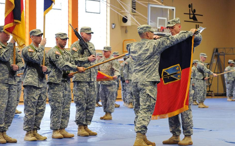 The commander of the 170th Infantry Brigade Combat Team, Col. Mark Raschke, left, and Command Sgt. Maj. James Ackermann roll up the brigade's colors at the unit's inactivation ceremony in Baumholder, Germany, Oct. 9, 2012. With its inactivation, and that of the 172nd Separate Infantry Brigade in Grafenwoehr, Germany seven months later, two of four heavy brigades were withdrawn from Europe. By 2015, about seven main garrisons and some 30,000 soldiers will remain in Europe.