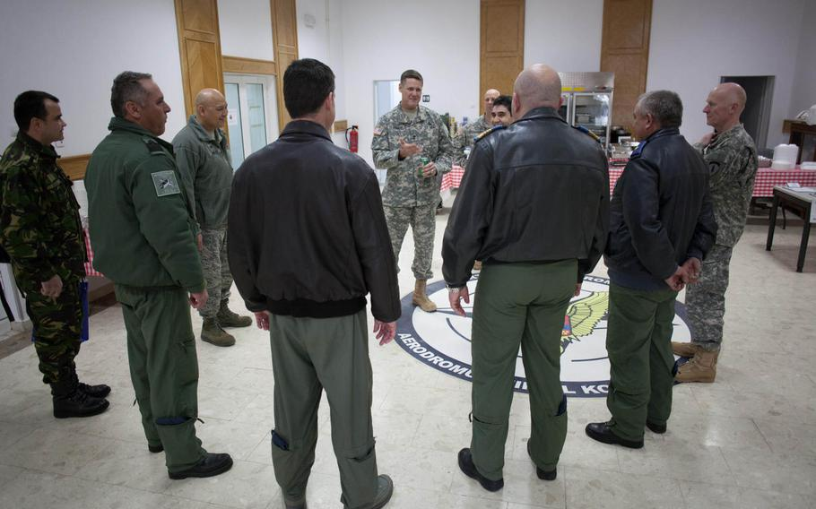 Maj. Gen. John O'Connor, commander of the 21st Theater Sustainment Command, talks with American and Romanian officers Feb. 28, 2014, at the new U.S. transit center at Mihail Kogalniceanu Air Base near Constanta, Romania.