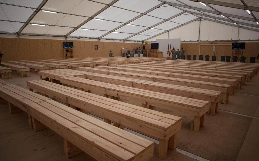 Benches in the processing tent at the new U.S. transit center at Mihail Kogalniceanu Air Base in Romania can accommodate roughly 300 personnel at a time. The new center will process up to 2,000 personnel a day heading to and from the war in Afghanistan.