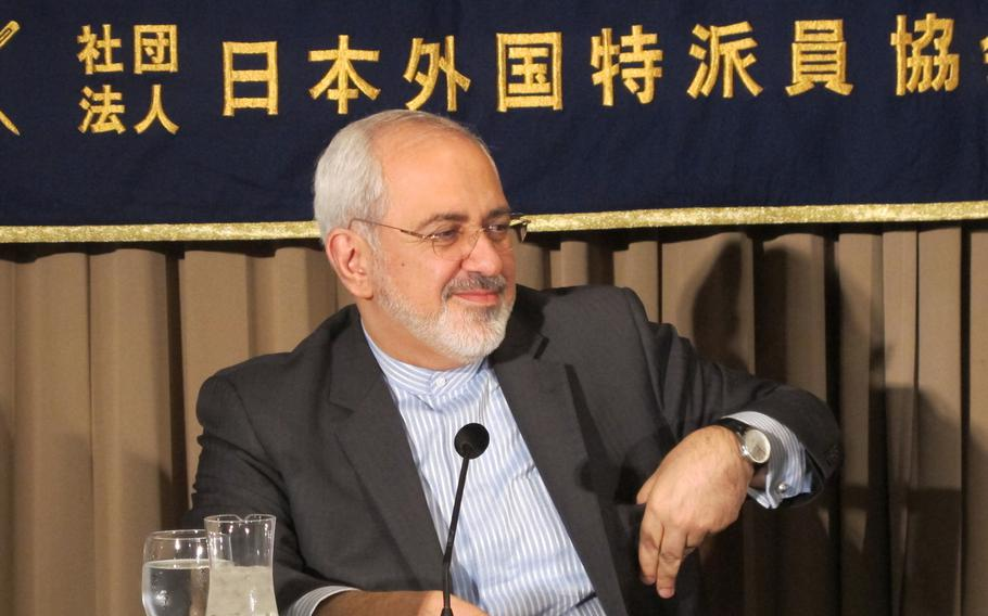 Iran Foreign Minister Mohammad Javad Zarif talks with reporters at a press conference in Tokyo on Wednesday. Zarif said that Iran was ready to show the world transparency in its development of the commercial nuclear program. Zarif also said that the U.S. military role in the Persian Gulf increased the chance for miscalculation and violence in the region.