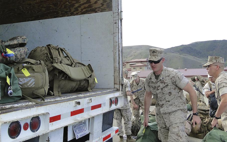 Marines load their bags onto trucks Monday morning at Camp Pendleton, Calif., as they prepare to leave for a six-month deployment to Australia. First Battalion, 5th Marine Regiment is the first battalion-sized unit to deploy to Australia, and will be joined in the Northern Territory by a small Hawaii-based aviation element.
