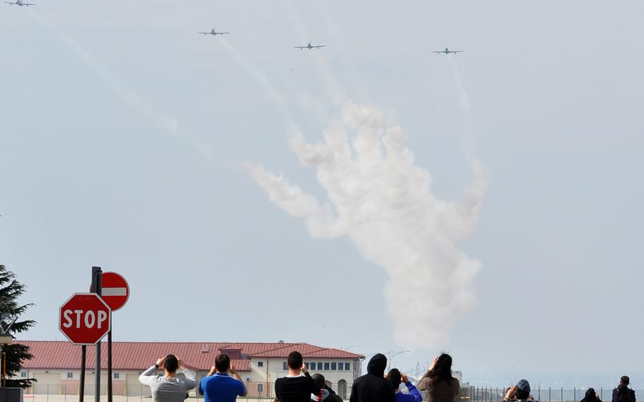 Dozens of Americans and Italians gathered both inside and outside Aviano Air Base on Friday, April 4, 2014, to watch a brief demonstration by Italy's national air acrobatic team, Frecce Tricolori.