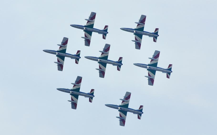 Seven members of Italy's national air acrobatics team, Frecce Tricolori, fly over Aviano Air Base during a demonstration Friday, April 4, 2014.