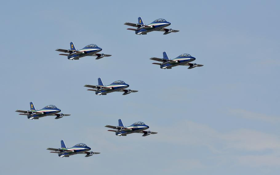 The seven-member Frecce Tricolori air acrobatics team passes over Aviano Air Base, Italy, on Friday, April 4, 2014. The jets are based at nearby Rivolto Air Base and perform a brief series of maneuvers at Aviano each year.