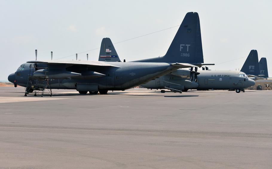 U. S. Air Force HC-130 and C-130 aircraft sit on the tarmac at Camp Lemonnier, Djibouti, Tuesday, April 1, 2014.