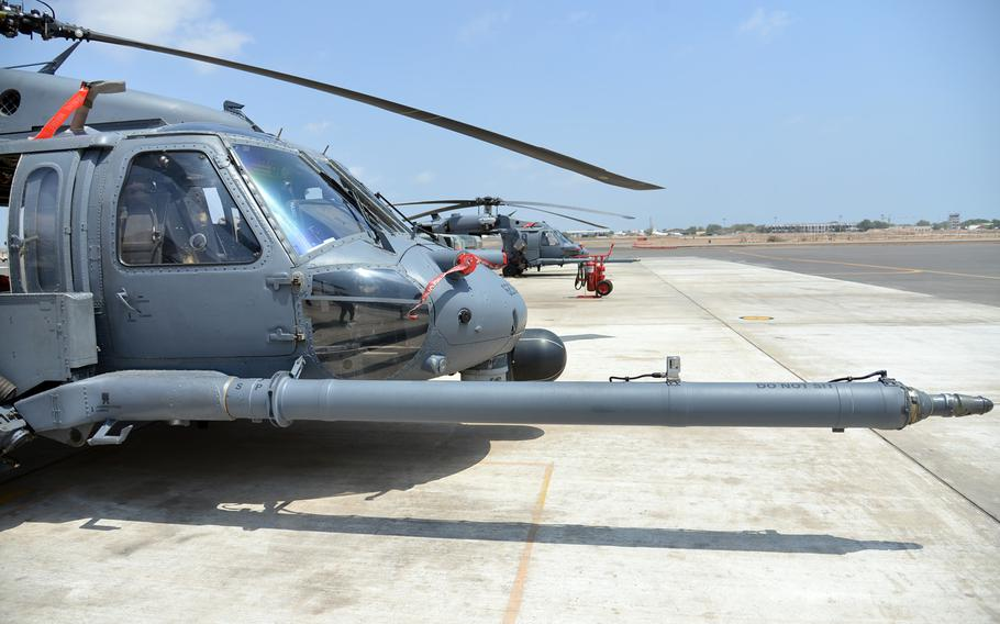 HH-60 Pave Hawk helicopters sit on the tarmac at Camp Lemonnier, Djibouti, Tuesday, April 1, 2014. The HH-60s are used mainly for personnel recovery missions