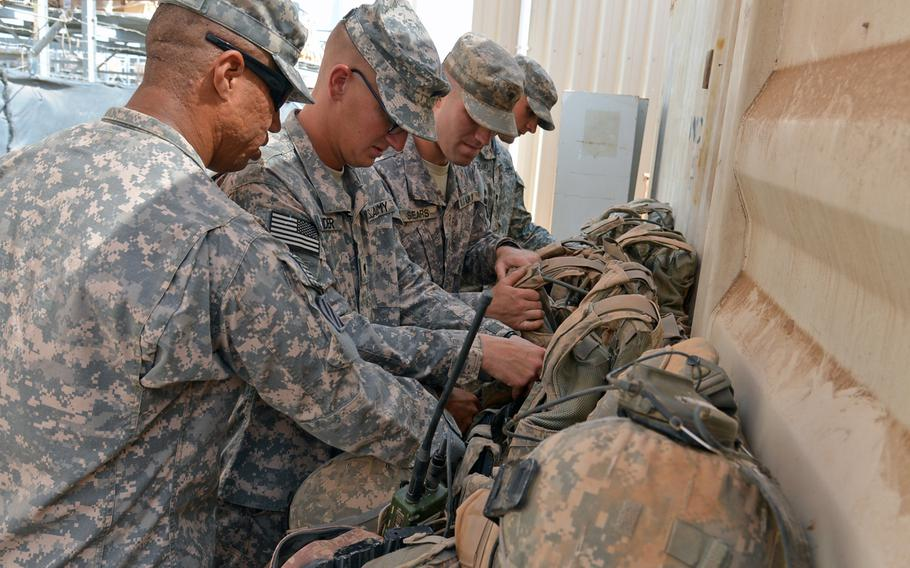 Soldiers of the Army's new East Africa Response Force from the 1st Combined Arms Battalion, 18th Infantry Regiment out of Fort Riley, Kan., deployed to Camp Lemonnier, Djibouti, inventory their equipment after returning from a training mission, Thursday, April 3, 2014.