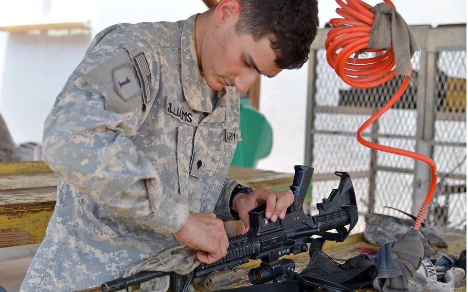Spc. Andrew Williams of the 1st Combined Arms Battalion, 18th Infantry Regiment cleans his M-4 weapon at Camp Lemonnier, Djibouti, Wednesday, April 2, 2014. The 1-18 Infantry Regiment has many missions in Djibouti. While one company of troops is always on call for crisis response, most of the remaining 700 soldiers in the unit provide security at Camp Lemonnier or travel across Africa to conduct training missions with U.S. partners.