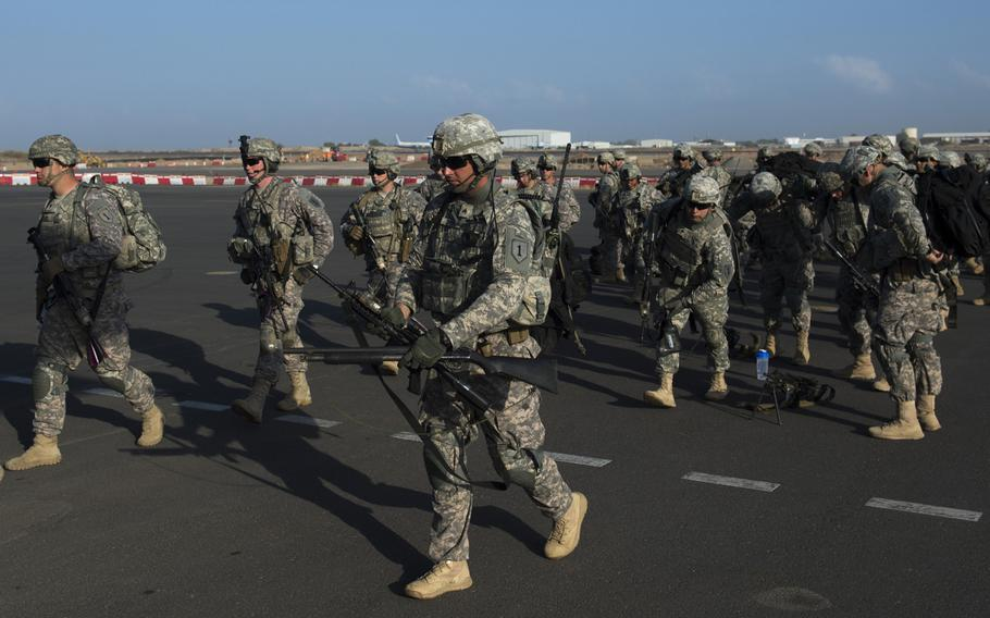 U.S. Army Soldiers with Combined Joint Task Force-Horn of Africa's East Africa Response Force (EARF) load onto a U.S. Air Force C-130 Hercules at Camp Lemonnier, Djibouti, Dec. 18, 2013. The EARF deployed to South Sudan supporting the departure of U.S. Embassy personnel.