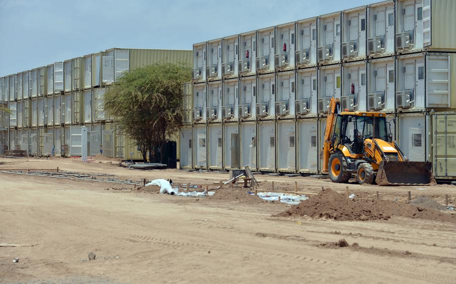 New triple-decked containerized housing units, seen here April 1, 2014, are slated to soon open on Camp Lemonnier, Djibouti.