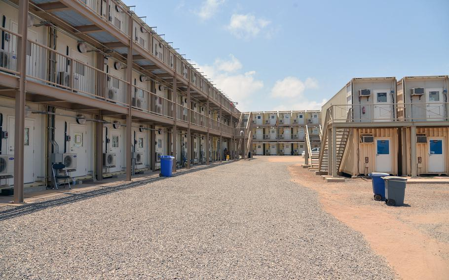 Triple and double-decked containerized housing units at Camp Lemonnier, Djibouti. New triple-decked containerized housing units also are slated to open soon.