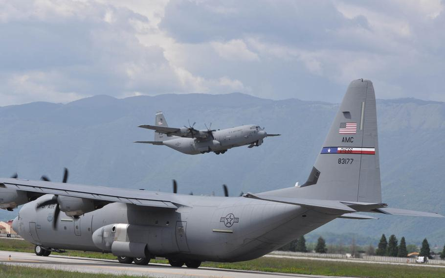 The second of two C-130 cargo planes from Ramstein Air Base, loaded with servicemembers from the 173rd Infantry Brigade Combat Team based in Vicenza, Italy, departs Aviano Air Base for Poland on Wednesday, April 23, 2014. The tail end of one of three C-130's taxis across the runway to take paratroopers from the 173rd to a drop zone for their required 90 day jump.