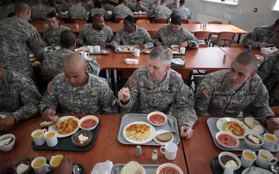 Lt. Gen. Donald Campbell Jr., commander of U.S. Army Europe, center, eats lunch with soldiers of the 173rd Infantry Brigade Combat Team in Adazi, Latvia, where a company of American soldiers deployed last week to reassure the NATO ally of the U.S. commitment to its security in the wake of Russia's actions in Ukraine.