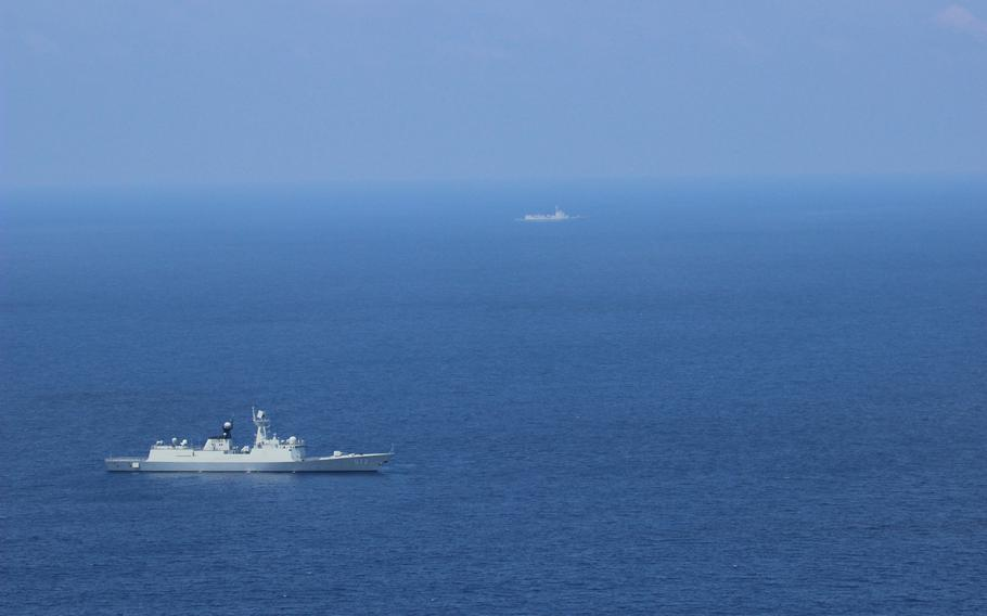 A Chinese navy vessel is seen from an MH-60 helicopter assigned to USS Blue Ridge as the U.S. Navy conducts flight operations in support of maritime security operations in the South China Sea.